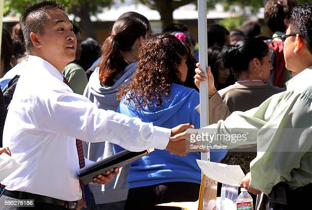 Jimmy Chang shakes hands after interviewing for a job with a prospective employer during a job fair at Palomar College in San Marcos CA on Wednesday...