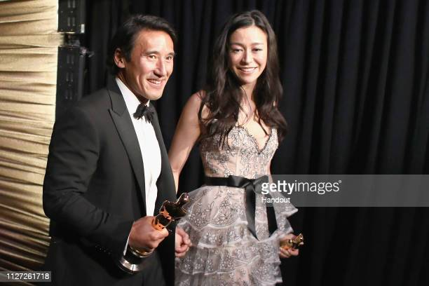 Jimmy Chin and Elizabeth Chai Vasarhelyi pose backstage with the Best Documentary Feature award for 'Free Solo backstage during the 91st Annual...