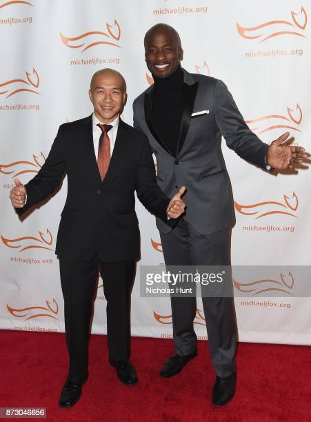 Jimmy Choi and Akbar Gbajabiamila on the red carpet of A Funny Thing Happened On The Way To Cure Parkinson's benefitting The Michael J Fox Foundation...