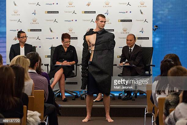 Jimmy Choo and judges view a students design at Fashion Tank - Perth on April 10, 2015 in Perth, Australia. Designer Professor Datuk Jimmy Choo in...