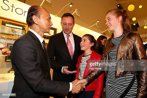 Jimmy Choo greets guests after officially opening The Story of Professor Jimmy Choo OBE at Claremont Quarter on August 7 2014 in Perth Australia