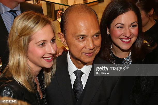 Jimmy Choo poses for photos with guests after officially opening The Story of Professor Jimmy Choo OBE at Claremont Quarter on August 7 2014 in Perth...
