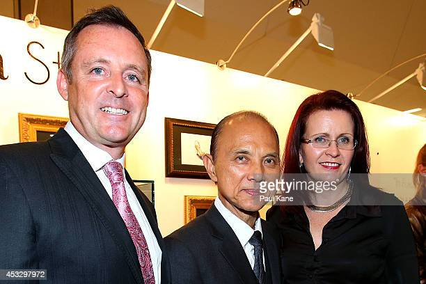 Jimmy Choo poses with Russell Gibbs and Kate O'Hara of Hawaiian after officially opening The Story of Professor Jimmy Choo OBE at Claremont Quarter...