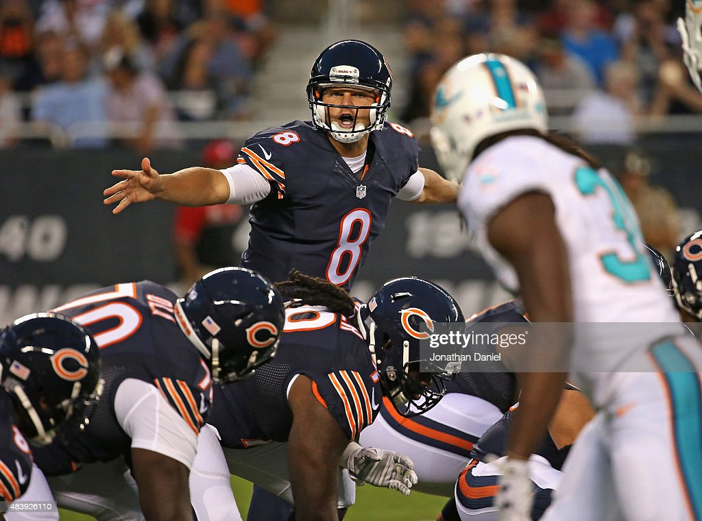 Jimmy Clausen #8 of the Chicago Bears calls a play against the Miami Dolphins during a preseason game at Soldier Field on August 13, 2015 in Chicago, Illinois.