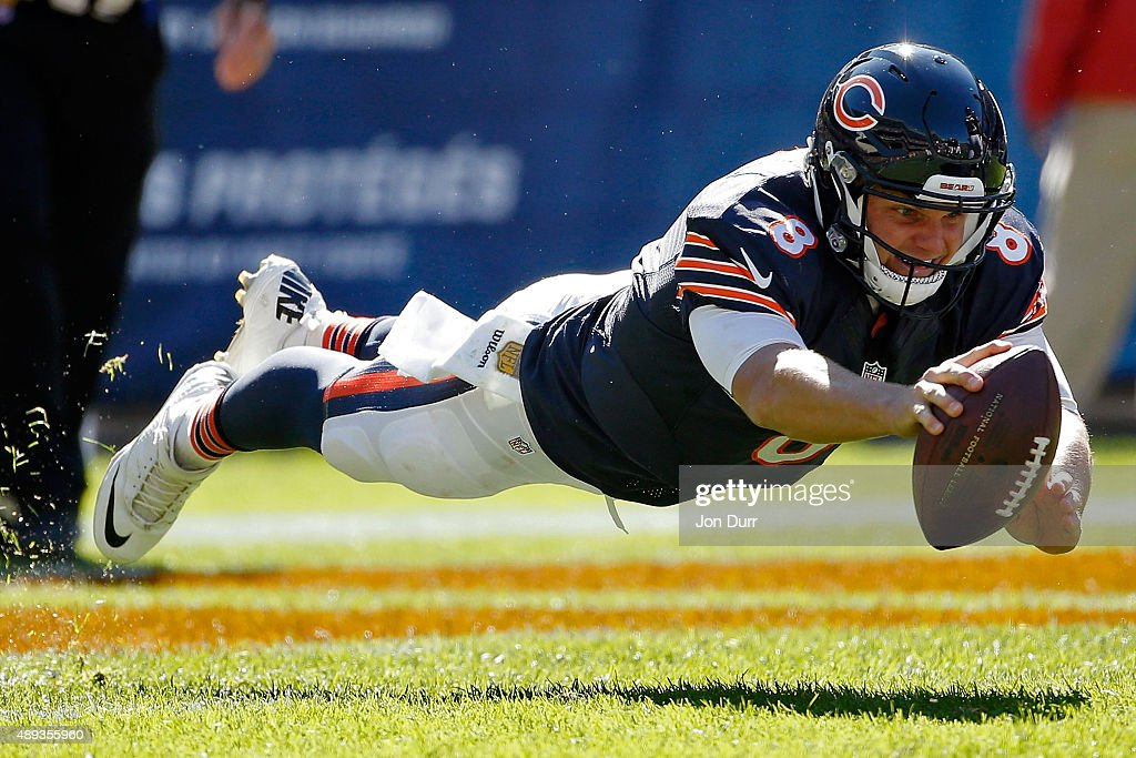 Jimmy Clausen #8 of the Chicago Bears dives as he recovers a fumble during the fourth quarter in the game against the Arizona Cardinals at Soldier Field on September 20, 2015 in Chicago, Illinois. The Arizona Cardinals won 48-23.