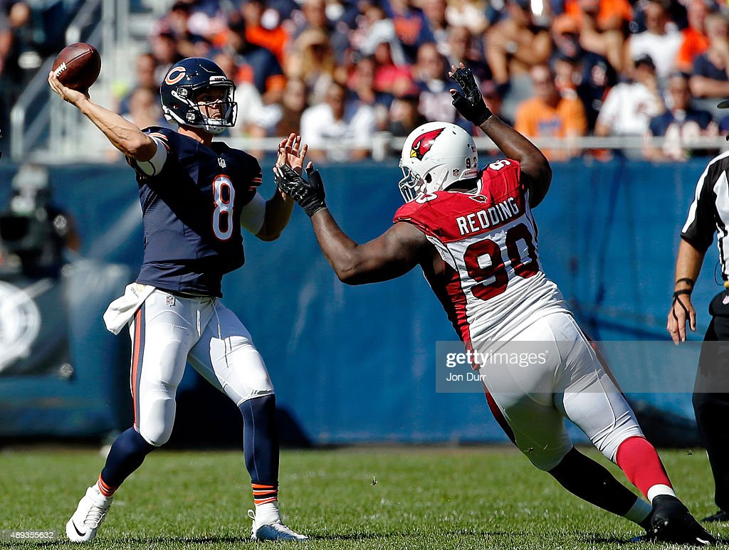 Jimmy Clausen #8 of the Chicago Bears passes the ball while defended by Cory Redding #90 of the Arizona Cardinals during the fourth quarter at Soldier Field on September 20, 2015 in Chicago, Illinois.
