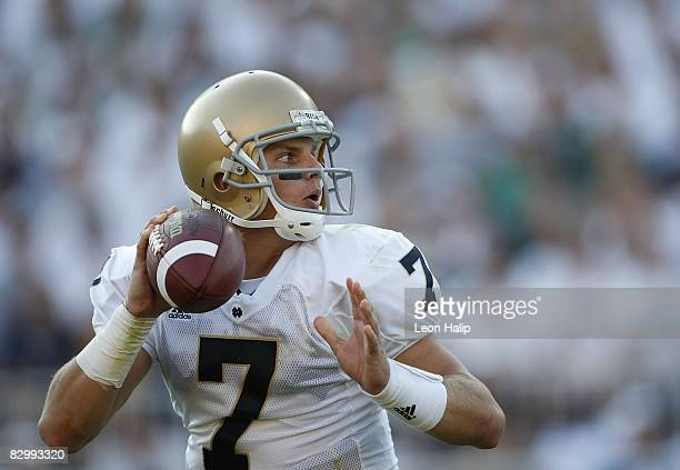 Jimmy Clausen of the Notre Dame Fighting Irish looks to throw a pass against the Michigan State Spartans on September 20, 2008 at Spartan Stadium in...