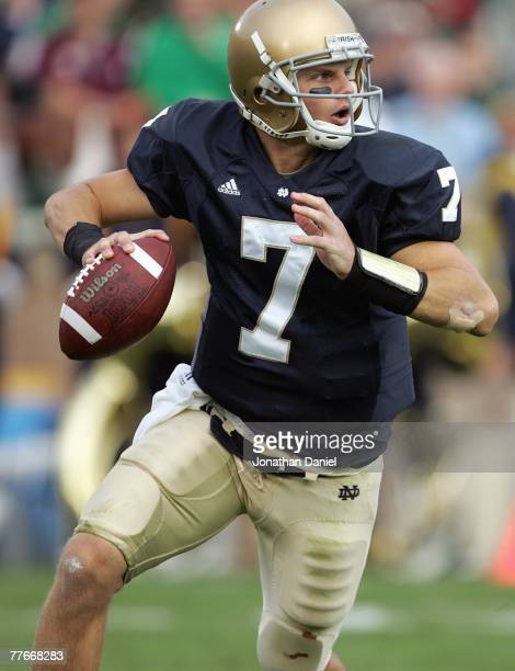 Jimmy Clausen of the Notre Dame Fighting Irish runs to pass the ball during the game against the Boston College Eagles on October 13 2007 at Notre...