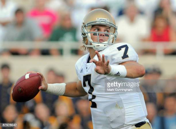Jimmy Clausen of the Notre Dame Fighting Irish throws a pass against the Michigan State Spartans on September 20, 2008 at Spartan Stadium in East...