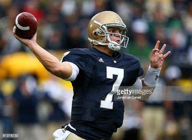 Jimmy Clausen of the Notre Dame Fighting Irish throws a pass against the Washington Huskies on October 3 2009 at Notre Dame Stadium in South Bend...