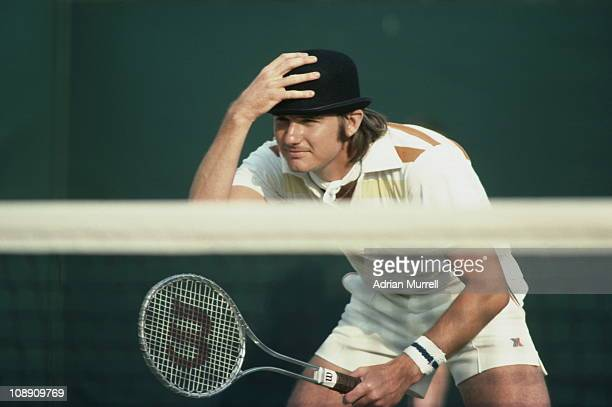 Jimmy Connors clowns and jokes with the spectators by wearing a bowler hat during a Men's Doubles match with partner Ilie Nastase at the Wimbledon...