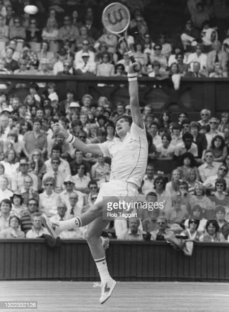 Jimmy Connors of the United States reaches to make an overhead forehand return against compatriot Roscoe Tanner during their Men's Singles Quarter...