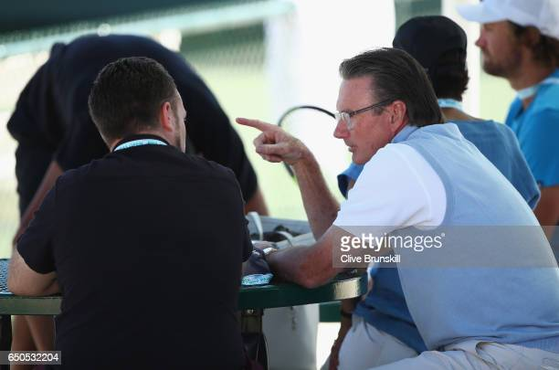 Jimmy Connors of the United States speaks with John Morris agent of Nick Kyrgios of Australia during his practice session during day four of the BNP...