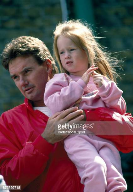 Jimmy Connors of the USA with his daughter Aubree at the Queen's Club in London circa June 1988