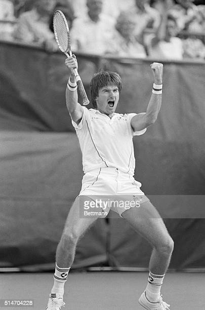 Jimmy Connors pumps his fists in the air after winning a crucial point in the second set of his match against Ivan Lendl in the finals of the 1983...