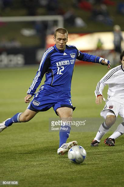 Jimmy Conrad of the Kansas City Wizards crosses the ball against DC United during the game at Community America Ballpark on March 29 2008 in Kansas...