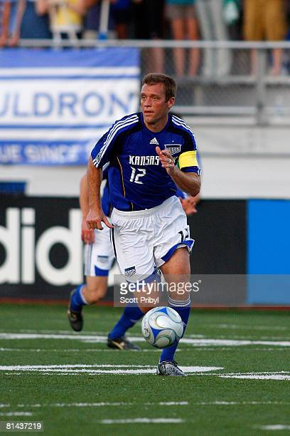 Jimmy Conrad of the Kansas City Wizards dribbles the ball against the Colorado Rapids during the game at Shawnee Mission North High School on June 4...
