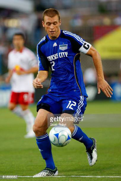 Jimmy Conrad of the Kansas City Wizards dribbles the ball against the New York Red Bulls at Community America Ballpark on July 10, 2008 in Kansas...