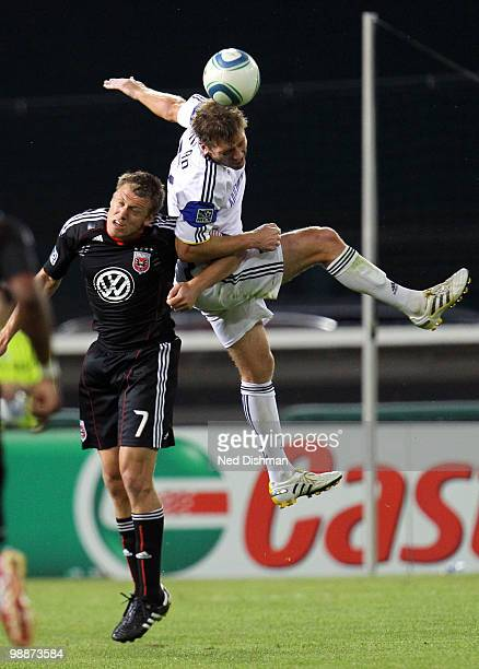 Jimmy Conrad of the Kansas City Wizards wins a header against Adam Christman of DC United at RFK Stadium on May 5 2010 in Washington DC