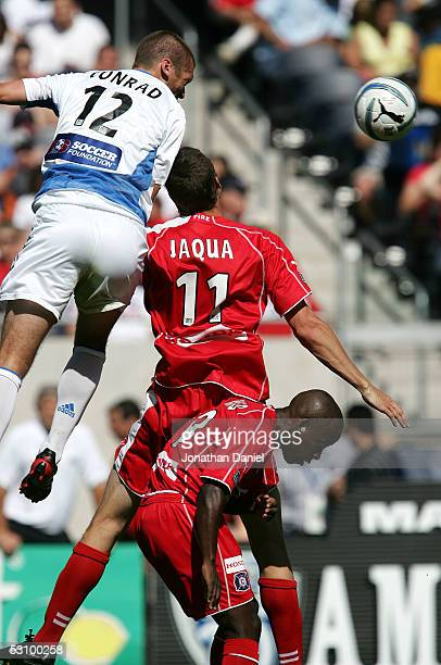 Jimmy Conrad of the Kansas City Wizards wins a header battle with Nate Jaqua and Thiago of the Chicago Fire on June 18 2005 at Soldier Field in...