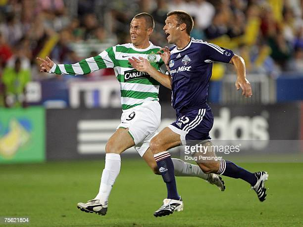 Jimmy Conrad of the MLS All-Stars and Kenny Miller of Glasgow Celtic FC vie for position during the 2007 Sierra Mist MLS All-Star Game at Dick's...