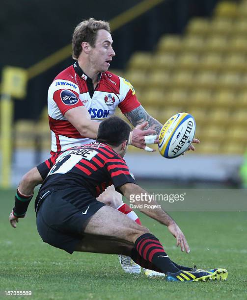 Jimmy Cowan of Gloucester is tackled by Neil de Kock during the Aviva Premiership match between Saracens and Gloucester at Vicarage Road on December...