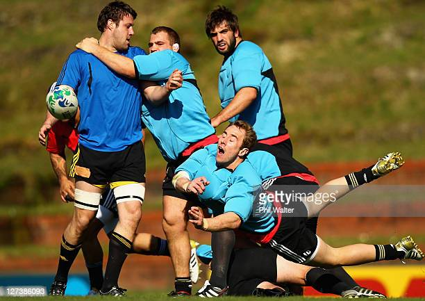 Jimmy Cowan of the All Blacks passes during a New Zealand All Blacks IRB Rugby World Cup 2011 training session at Rugby League Park on September 28...