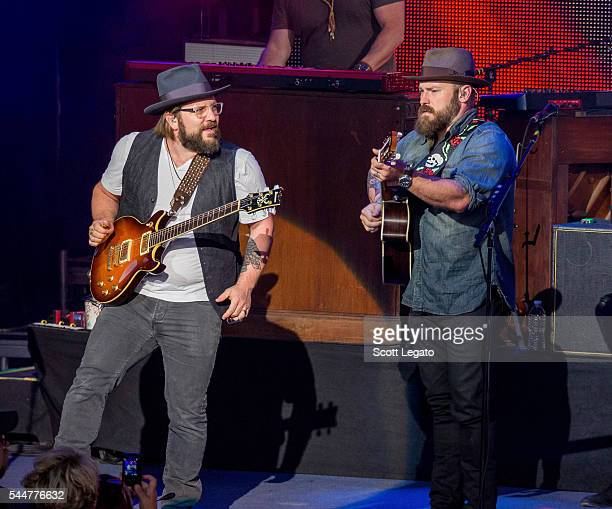 Jimmy De Martini and Zac Brown band perform during the Black Out The Sun Tour at DTE Energy Music Theater on July 2 2016 in Clarkston Michigan