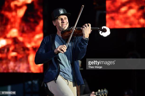 Jimmy De Martini of Zac Brown Band performs on stage during the Down The Rabbit Hole Tour in Boston at Fenway Park on June 15 2018 in Boston...