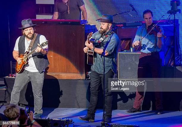 Jimmy De Martini Zac Brown and Coy Bowles of the Zac Brown band perform during the Black Out The Sun Tour at DTE Energy Music Theater on July 2 2016...