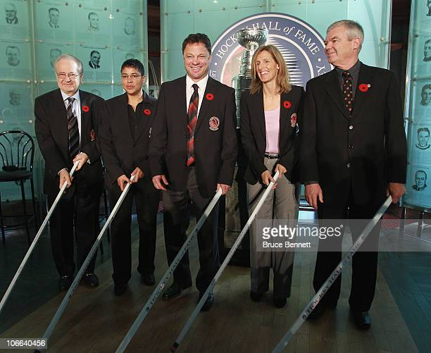 Jimmy Devellano Angela James Dino Ciccarelli Cammi Granato and Bob Seaman appear at a media opportunity prior to their induction ceremony to the...