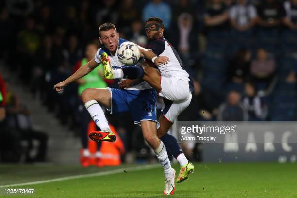 Jimmy Dunne of Queens Park Rangers and Darnell Furlong of West Bromwich Albion during the Sky Bet Championship match between West Bromwich Albion and...