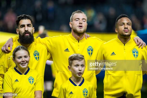 Jimmy Durmaz, John Giudetti, and Martin Olsson of Sweden stand for the national anthem during the International Friendly match between Sweden and...