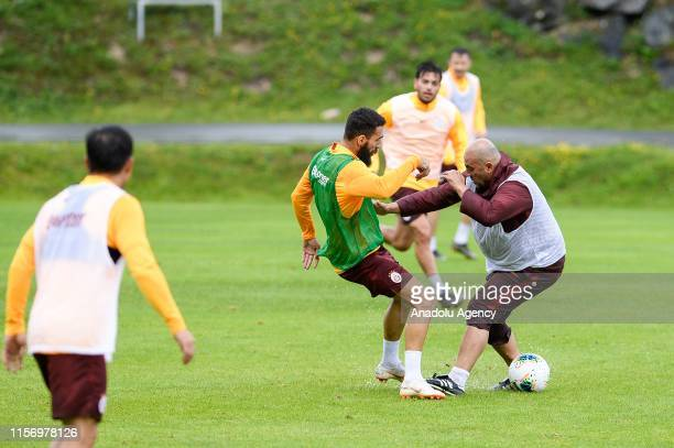 Jimmy Durmaz of Galatasaray and Galatasaray's assistant coach Hasan Sas attend a training session within summer camp as part of the Turkish Super Lig...