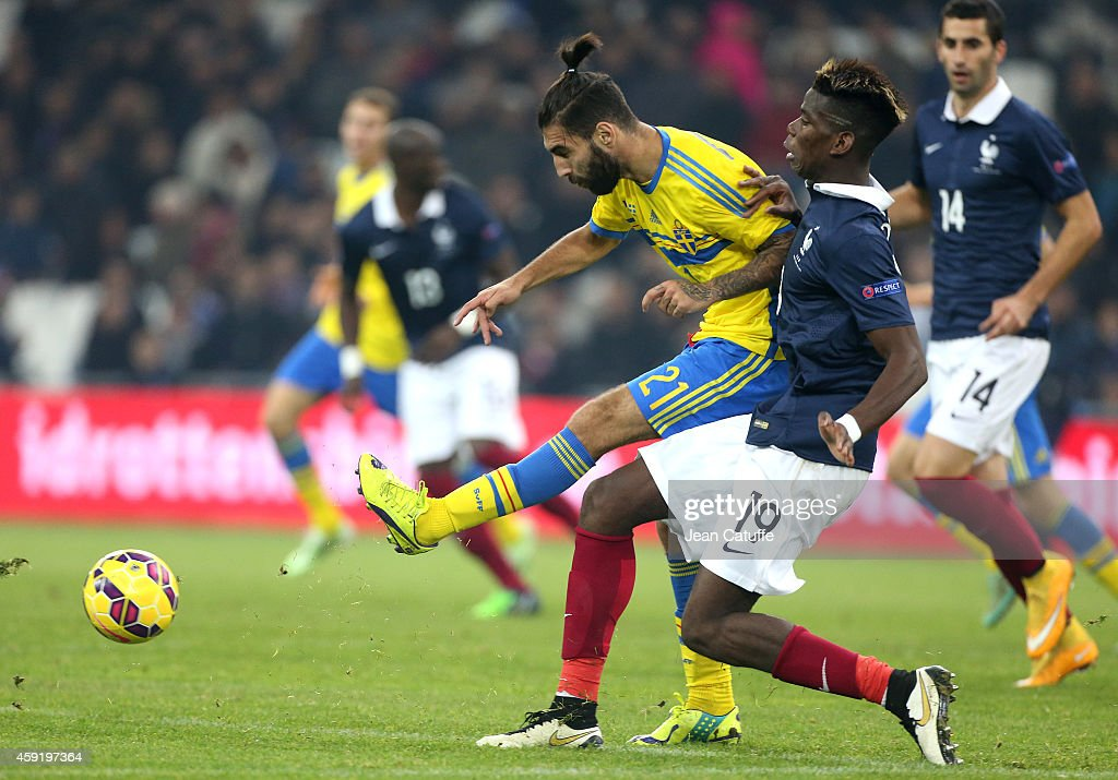 Jimmy Durmaz of Sweden and Paul Pogba of France in action during the international friendly match between France and Sweden at the Stade Velodrome on November 18, 2014 in Marseille, France.