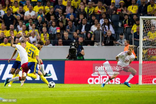 Jimmy Durmaz of Sweden shots on at goal during an international friendly match between Sweden and Denmark at Friends Arean on June 2, 2018 in...