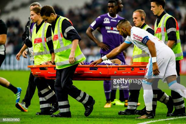Jimmy Durmaz of Toulouse leave the pitch injured during the Ligue 1 match between Olympique Marseille and Toulouse at Stade Velodrome on September 24...