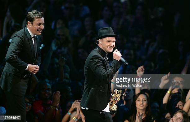 Jimmy Fallon and Justin Timberlake speak onstage during the 2013 MTV Video Music Awards at the Barclays Center on August 25 2013 in the Brooklyn...