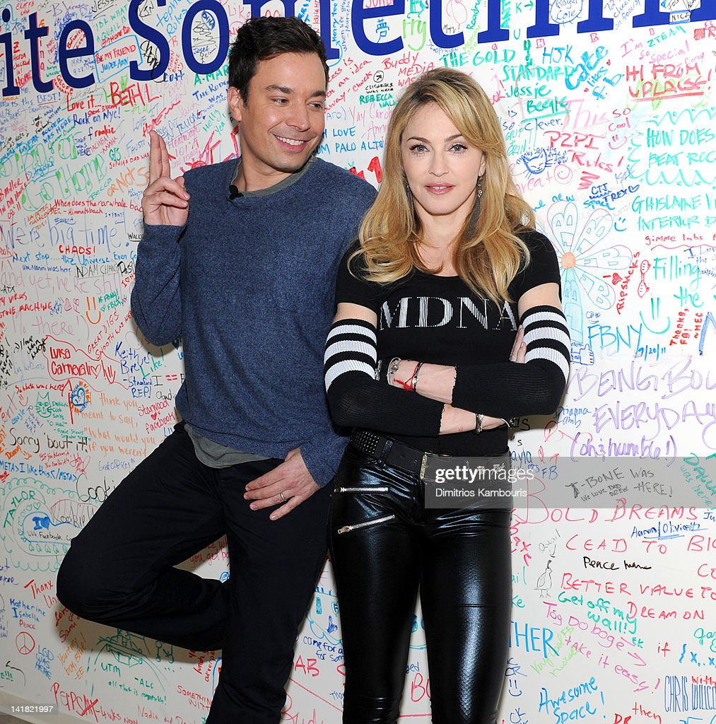 Jimmy Fallon and Madonna pose at the Facebook wall before their livestream interview at the Facebook offices on March 24, 2012 in New York City.