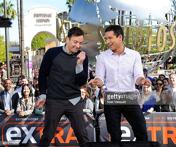 Jimmy Fallon and Mario Lopez visit 'Extra' at Universal Studios Hollywood on February 5 2015 in Universal City California