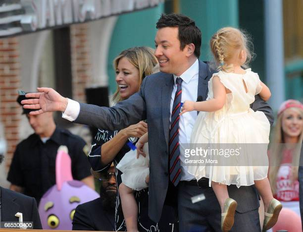 Jimmy Fallon his wife Nancy Juvonen and daugther Frances greet the audience during the Grand Opening of Universal Orlando's Newest Attraction Race...