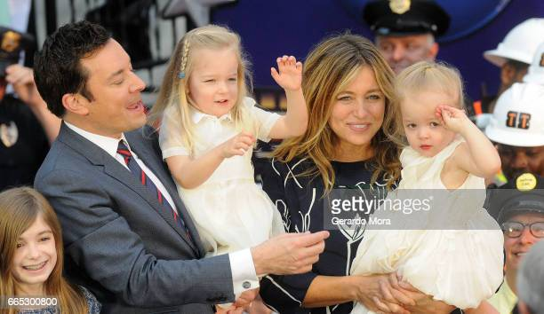 Jimmy Fallon his wife Nancy Juvonen and daugthers Winnie and Frances greet the audience during the Grand Opening of Universal Orlando's Newest...