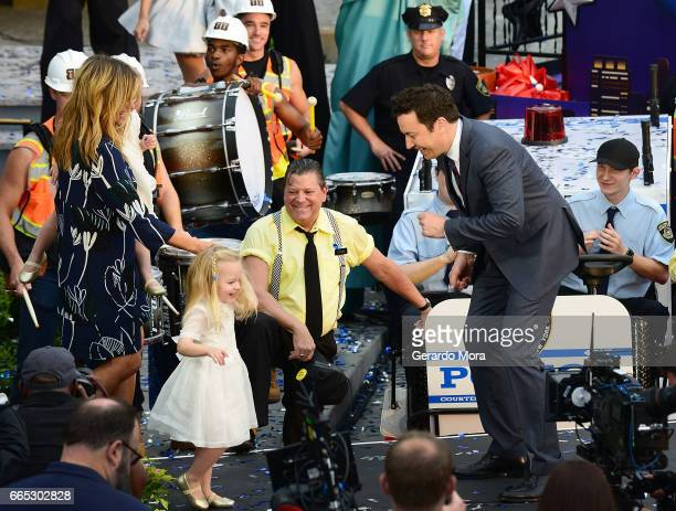 Jimmy Fallon his wife Nancy Juvonen and daugthers Winnie and Frances dance during the Grand Opening of Universal Orlando's Newest Attraction Race...