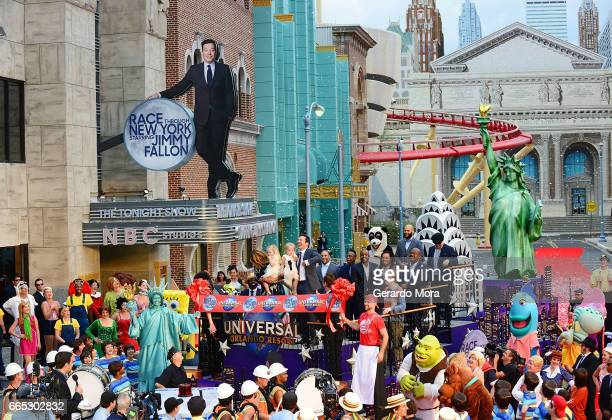 Jimmy Fallon his wife Nancy Juvonen and daugthers Winnie and Frances laugh during the Grand Opening of Universal Orlando's Newest Attraction Race...