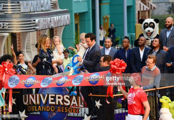 Jimmy Fallon his wife Nancy Juvonen and daugthers Winnie and Frances cut the ribbon during the Grand Opening of Universal Orlando's Newest Attraction...