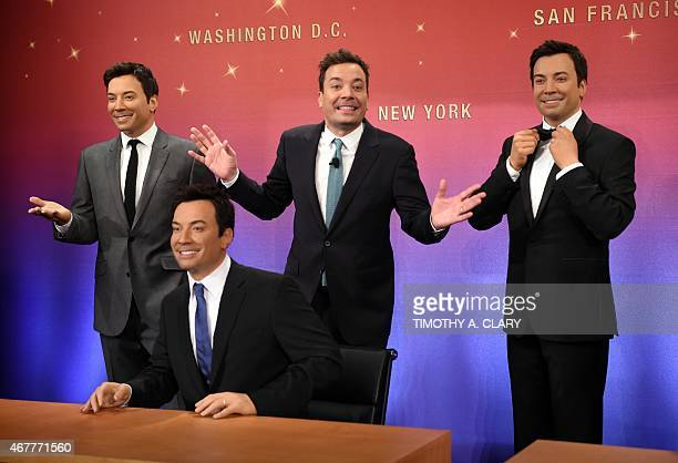 Jimmy Fallon host of NBCs The Tonight Show poses with his new wax figures at Madame Tussauds New York on March 27 2015 The event mark Fallons one...