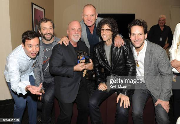 Jimmy Fallon Judd Apatow Billy Joel Sting Howard Stern and Paul Rudd backstage at Madison Square Garden on May 9 2014 in New York City