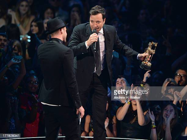 Jimmy Fallon presents Justin Timberlake the Michael Jackson Video Vanguard Award during the 2013 MTV Video Music Awards at the Barclays Center on...