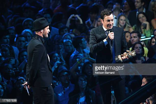 Jimmy Fallon presents Justin Timerlake with a VMA onstage during the 2013 MTV Video Music Awards at the Barclays Center on August 25 2013 in the...