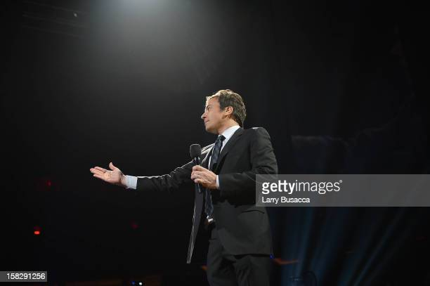 Jimmy Fallon speaks onstage at '121212' a concert benefiting The Robin Hood Relief Fund to aid the victims of Hurricane Sandy presented by Clear...